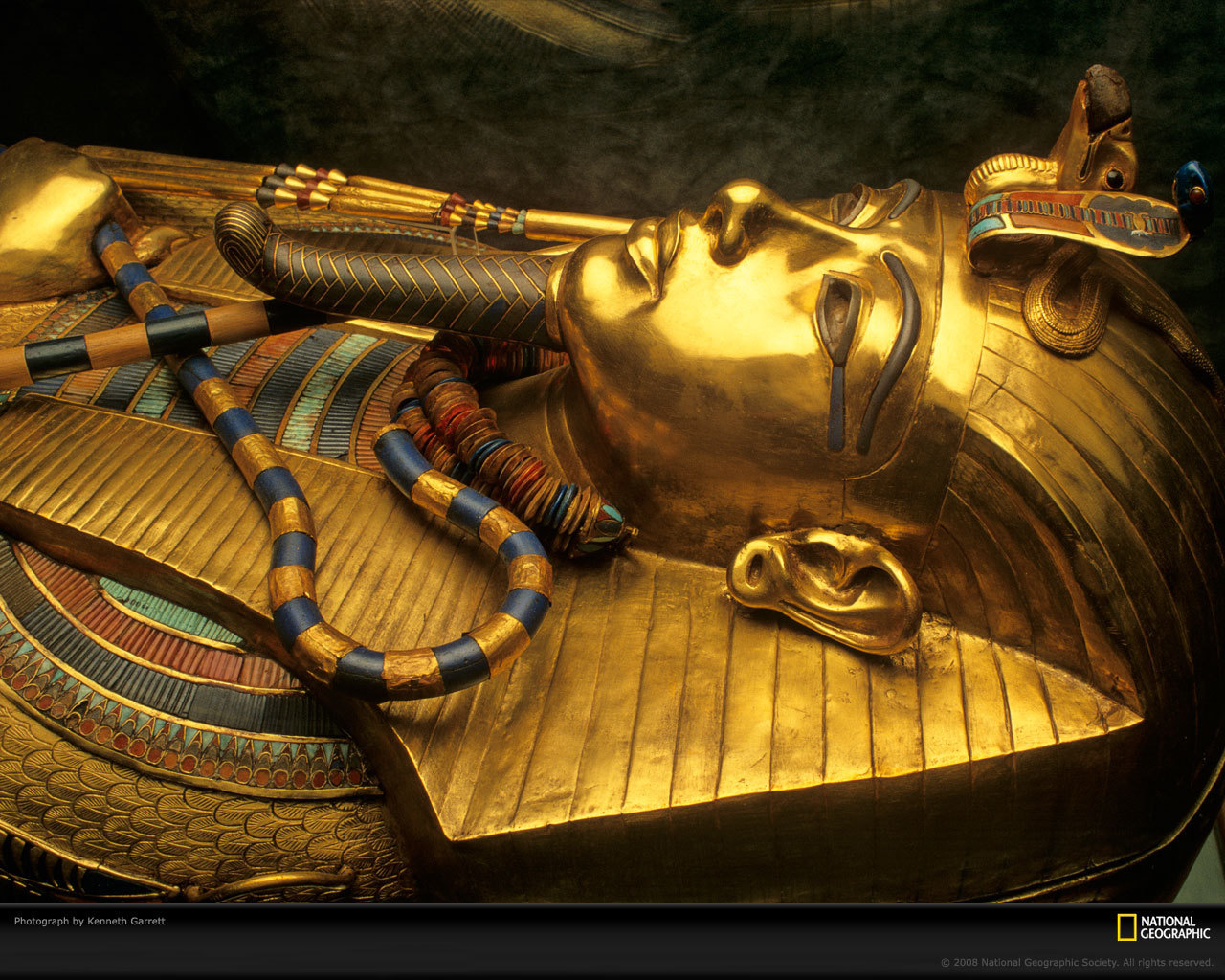 King Tutankhamen sarcophagus showing stretched ear lobe